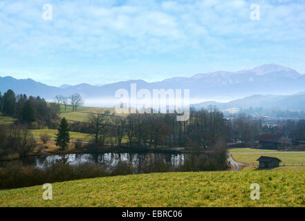 view to small lake and Karwendel Mountains in morning mist, Germany, Bavaria, Oberbayern, Upper Bavaria, Habach - Stock Photo