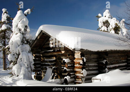 snow covered log cabin, Finland, Lapland - Stock Photo