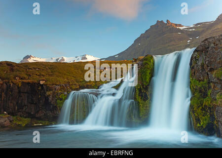 idyllic waterfall flowing from glacier, Iceland, Snaefellsnes - Stock Photo
