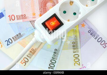 switchable socket board on Euro bills - Stock Photo