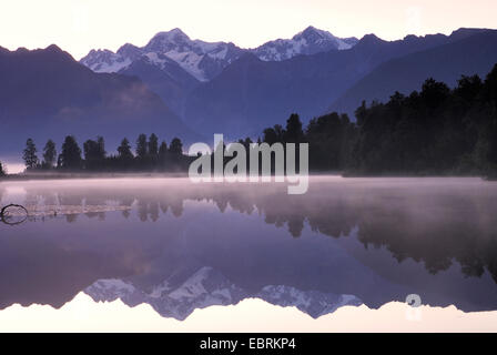 Mt. Tasman and Mt. Cook (Aoraki) mirroring in Lake Matheson, New Zealand, Southern Island, Westland National Park - Stock Photo