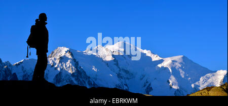 silhouette of mountaineer in front of Mont Blanc mountain, France, Haute-Savoie, Chamonix - Stock Photo