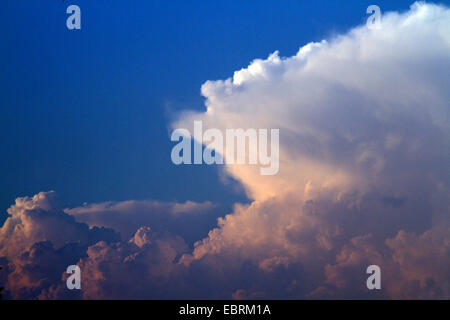 cumulonimbus clouds with incus, Germany - Stock Photo