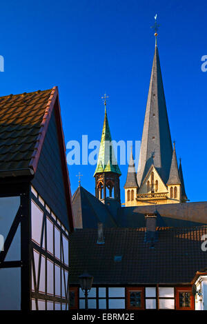 timbered houses and staple of the church Sankt Vincent in Menden, Germany, North Rhine-Westphalia, Sauerland, Menden - Stock Photo