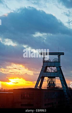 Doppelbock headframe of coal pit Ewald at sunset, Germany, North Rhine-Westphalia, Ruhr Area, Herten - Stock Photo