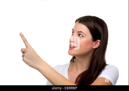 young darkhaired woman showing something with forefinger