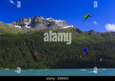 kitesurfers on Lake Silvaplana at the Piz Corvatsch, Switzerland, Grisons, Engadine - Stock Photo