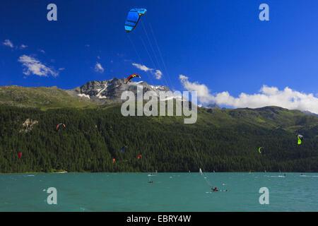 kitesurfers on Lake Silvaplana at the Piz Corvatsch, Switzerland, Grisons, Engadine - Stock Photo