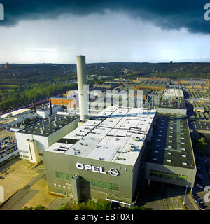 dark clouds over Opel's manufacturing plant in Bochum, Germany, North Rhine-Westphalia, Ruhr Area, Bochum - Stock Photo