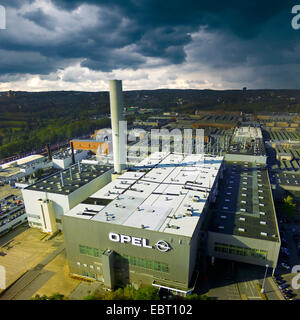 dark clouds over Opel's manufacturing plant in Bochum, Germany, North Rhine-Westphalia, Ruhr Area, Bochum - Stock Photo