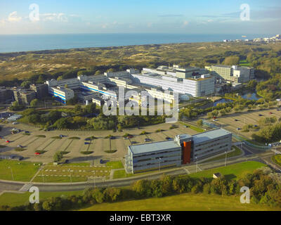 aerial view to the European Space Research and Technology Centre, North Sea Coast and Coepelduynen in background, - Stock Photo