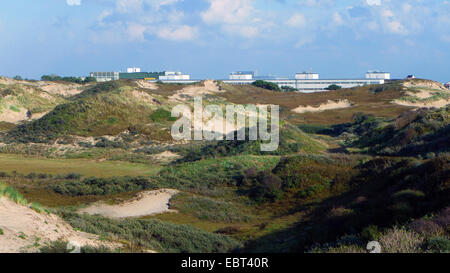 grass-grown dunes Coepelduynen at the North Sea Coast, European Space Research and Technology Centre in background, - Stock Photo
