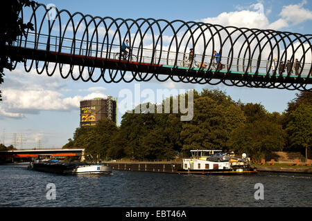 modern pedestrian and cycle bridge over the Rhine-Herne Canal, Germany, North Rhine-Westphalia, Ruhr Area, Oberhausen - Stock Photo