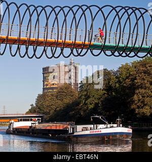 Slinky Springs to fame bridge, Rehberger Bruecke, Gasometer Oberhausen in the background, Germany, North Rhine-Westphalia, - Stock Photo