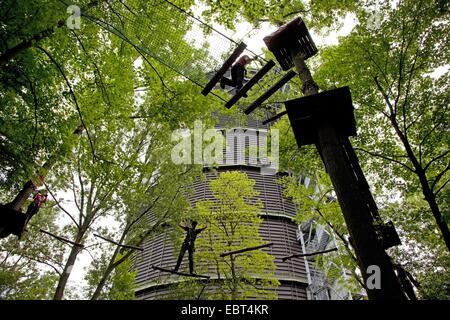 people climbing on climbing crag in front of gasometer Oberhausen, Germany, North Rhine-Westphalia, Ruhr Area, Oberhausen - Stock Photo