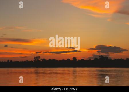 sunset on Amazon River,  Rio Solim�es, Brazil, amazonas - Stock Photo