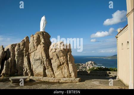 statue Dame de la Serre and chapel Notre Dame de la Serra , France, Corsica, Calvi - Stock Photo