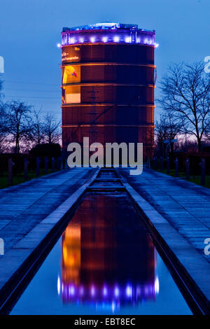 illuminated gasometer, view from Olga park, Germany, North Rhine-Westphalia, Ruhr Area, Oberhausen - Stock Photo