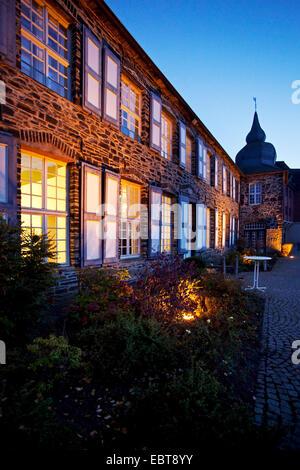 illuminated Holtzbrinck Castle in evening light, Germany, North Rhine-Westphalia, Sauerland, Altena - Stock Photo