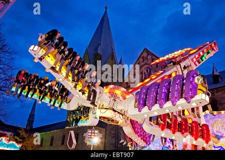 fun fair Allerheiligekirmes in front of St Patrokli cathedral in Soest, Germany, North Rhine-Westphalia, Sauerland, - Stock Photo