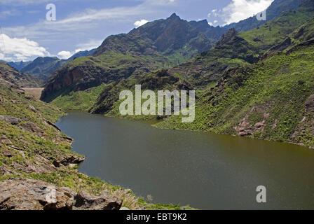 view from a mountain slope at the storage lake 'Presa Caidero de la Nina', Canary Islands, Gran Canaria - Stock Photo
