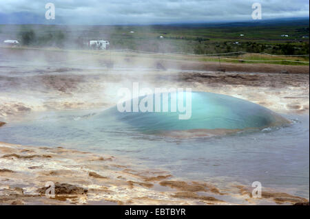 the geyser 'Strokkur' in the geothermal area of the valley Haukadalur, Iceland - Stock Photo