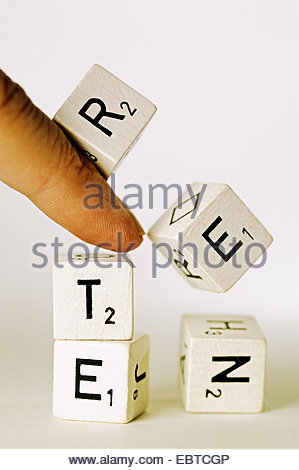 symbol picture 'collapsing tax-financed pension system' with a falling  tower of letters forming the word 'pension' - Stock Photo