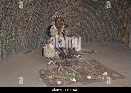 Zulu medicine man in a traditional house in an open air museum, South Africa, Kwazulu-Natal, DumaZulu - Stock Photo