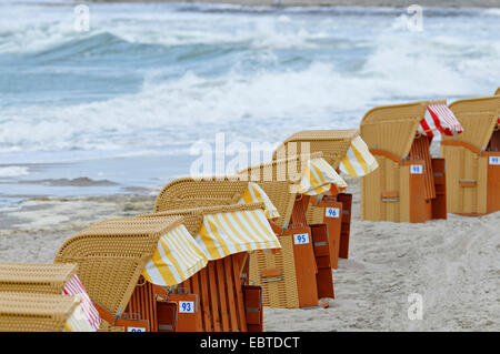 roofed wicker beach chairs on Baltic Sea beach, Germany, Mecklenburg-Western Pomerania - Stock Photo