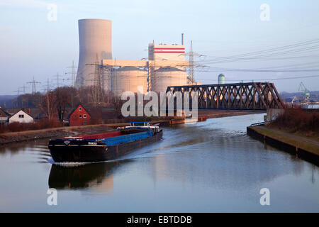 cargo ship on Datteln-Hamm Canal, Lippewerk in background, Germany, North Rhine-Westphalia, Ruhr Area, Waltrop - Stock Photo
