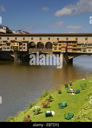 The Ponte Vecchio (Old Bridge) over the Arno River in Florence - Stock Photo