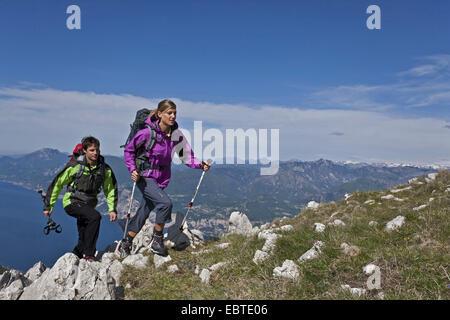 young couple mountain hiking at the Monte Altissimo at Lake Garda, Italy, Lake Garda - Stock Photo