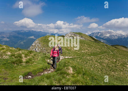 young couple hiking in the mountains, Austria, Styria, Altaussee - Stock Photo