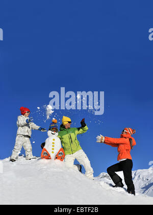 family doing a snowball fight , France - Stock Photo