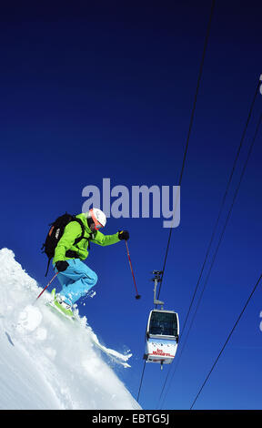 skier and cablecar, France, Savoie - Stock Photo