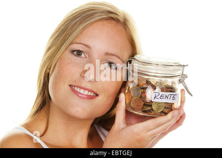 young woman saving money in a preserving jar for her pension - Stock Photo
