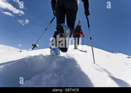 two skiers climbing up a snow-covered mountain crest, Austria, Grossglockner - Stock Photo