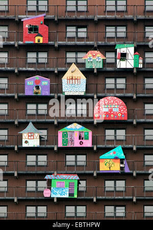 work of art 'Das Glueck' of HA Schult at the facade of a tower block, Germany, North Rhine-Westphalia, Ruhr Area, - Stock Photo