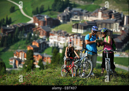 family mountain biking France Savoie La Plagne Stock Photo