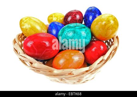 coloured easter eggs in a basket - Stock Photo