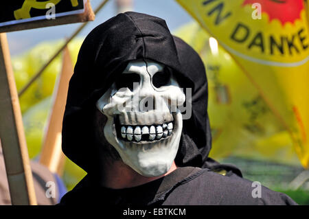 activist with skull mask at anti-nuclear demonstration near nuclear power station Grundremmingen, Germany, Bavaria, - Stock Photo