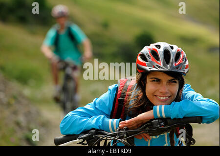 teenage girl with mountain bike having a break, France, Savoie - Stock Photo