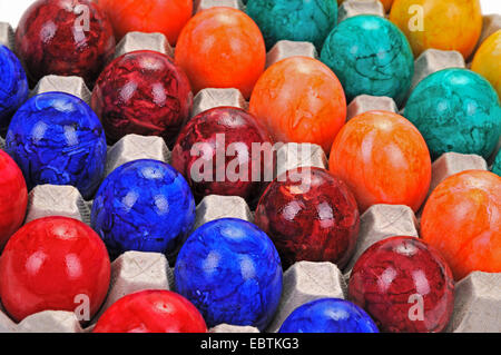colourful easter eggs in an egg carton - Stock Photo