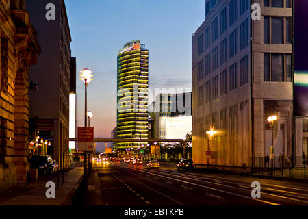 view from Leipziger Strasse to illuminated Bahntower at Potsdamer Platz in the evening, Germany, Berlin - Stock Photo