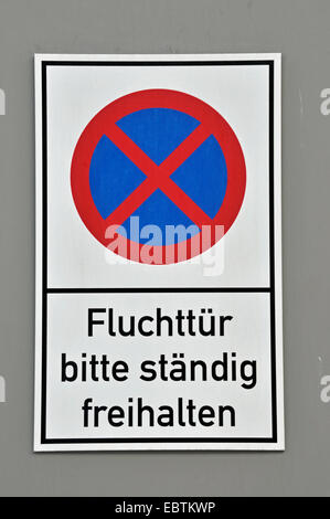 no parking sign 'escape door keep always clear', Germany - Stock Photo