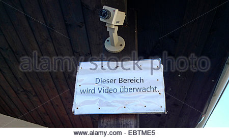 observation camera fake and note 'area under video surveillance', Germany - Stock Photo