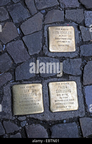 memorial plates in the pavement called 'Stolpersteine' (stumbling blocks) to bear deported Jews in remembrance, - Stock Photo