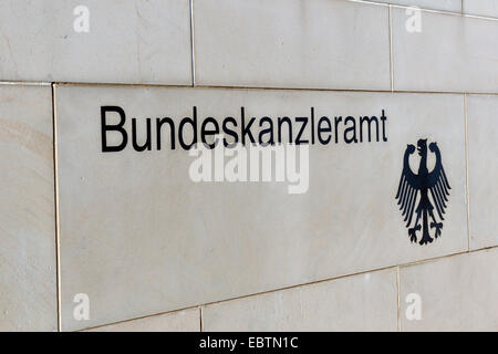 'Bundeskanzleramt' and federal eagle at the wall of German chancellery, Germany, Berlin - Stock Photo