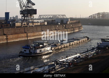 dockside crane of inner harbour and transport ship in canal, Germany, North Rhine-Westphalia, Ruhr Area, Duisburg - Stock Photo