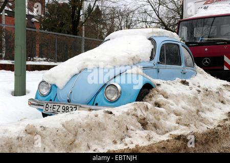 snowcovered Volkswagen Beetle, Germany, Berlin - Stock Photo
